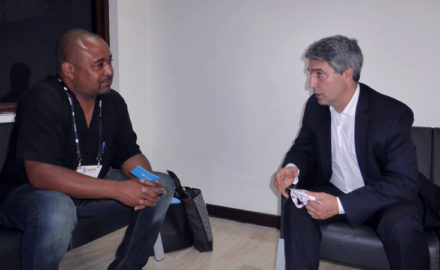 Marcelo González (right), CEO VeriTran, speaks with Loren Moss (left) of FInance Colombia. (Photo credit: Loren Moss)