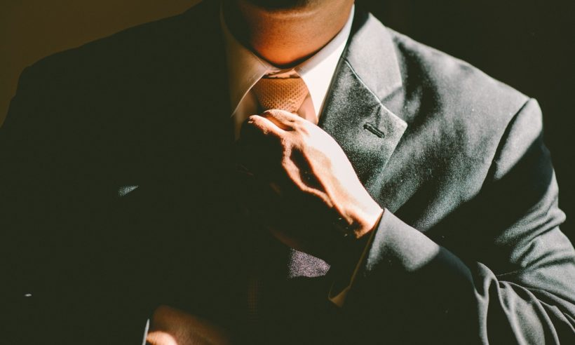 Chief executive officer (CEO) adjusting his tie and getting ready to work. (Credit: Free-Photos / Pixabay)