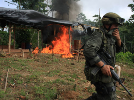 Colombian law enforcement burn a coca laboratory in the Colombian department of Narino. (Credit: Policía Nacional de Colombia / AP, William Fernando Martinez)