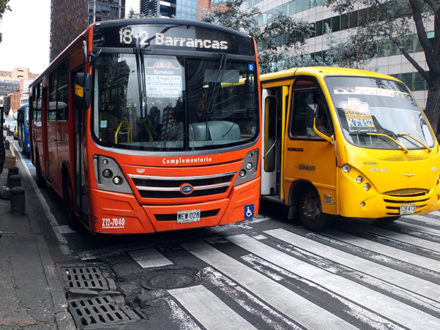 Buses operating on the streets of Bogota, Colombia. (Photo credit: Jared Wade)