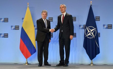 Juan Manuel Santos shakes hands with Jens Stoltenberg, secretary general of NATO, in the president's visit to advance Colombia's relationship with the alliance as a