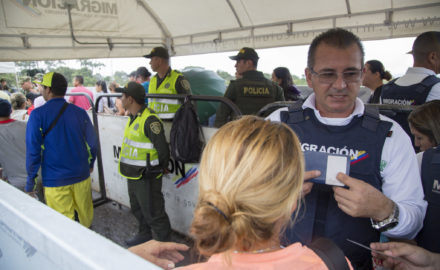 Migration officials work at the Colombian/Venezuelan border city of Cúcuta, where tens of thousands of Venezuelans cross every day due to the desperate social conditions and economic crisis occurring in their homeland. (Credit: National Police of Colombia)