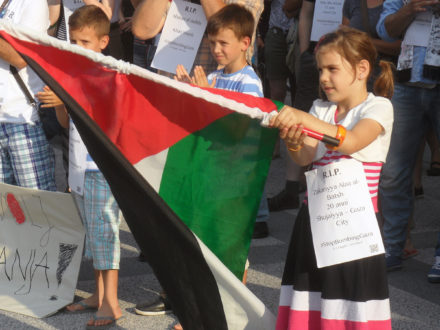 A young girl waves a Palestine flag during a 2014 protest in Slovenia. (Photo credit: MZaplotnik)