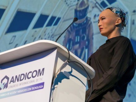 Sophia the Robot speaks on stage during Andicom 2018 in Cartagena, Colombia. (Photo credit: Jared Wade)
