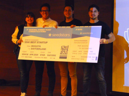The winners celebrate on stage in Bogotá. (Credit: Seedsters)