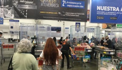 Above: PriceSmart has installed enclosures around cashiers to isolate them from shoppers during checkout, along with other safety measures. Pricesmart Medellín photo: Loren Moss