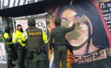 Colombian police paint over a mural of Julieth Ramirez, who was killed by a police gunfire while protesting the death of Javiér Ordoñez.