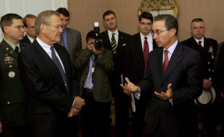 Secretary of Defense Donald H. Rumsfeld (left) listens as President Álvaro Uribe (right) speaks to a group assembled at the Colombian presidential residence on August 19, 2003. (Photo by TSGT Andy Dunaway, U.S. Air Force)